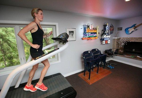 Suzy Favor Hamilton works out at her home in Madison, Wis., in July.