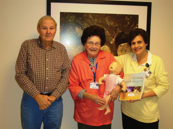 The Jefferson Memorial Hospital Auxiliary recently purchased textbooks and instructor tool kits for the STABLE classes at Jefferson Memorial Hospital in Ranson, W.Va. STABLE stands for Sugar and Safe Care, Temperature, Airway, Blood Pressure, Lab Work, Emotional Support. The program, taught by Dr. Robert Jones, is designed to provide information about neonatal stabilization for maternal and infant health care providers. From left, Gene Myers, treasurer of the hospital auxiliary, and Nancy Morgan, president, are shown presenting some of the STABLE class materials to Val Penick, RN, education manager at Jefferson Memorial Hospital. The Jefferson Memorial Hospital auxiliary holds various fundraising events throughout the year to be able to give back to the hospital when needs arise.
