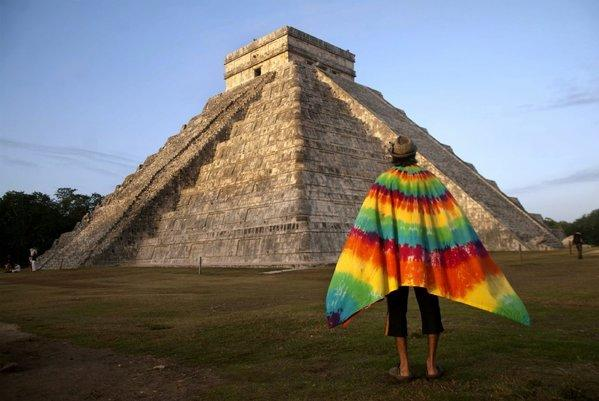 A man looks at Kukulkan pyramid as he takes part in a ritual in Chichen Itza, Mexico, on Friday. The ritual at the Maya site on the Yucatan Peninsula is a celebration of the beginning of a new era in the Maya calendar.