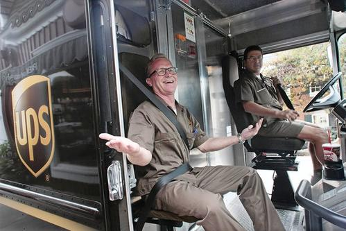 Erskine helps UPS driver Dave Nieto deliver Christmas and holiday packages in Santa Monica. The easy part of the day? Driving.