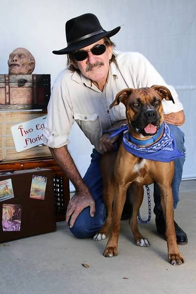 Charlie Carlson and his boxer Lady Isabel traveled 1,500 miles of Florida roads to explore some of the state's wackier places and more colorful personalities.