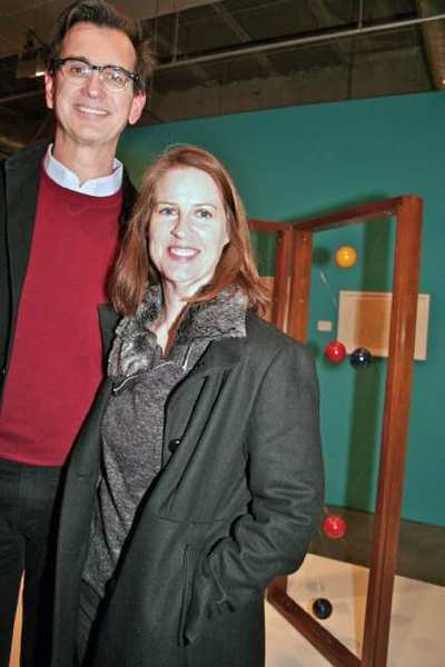 Pasadena Museum of California Art members Timothy Sales and wife Denice Waters take a tour of exhibits during the holiday party for members.