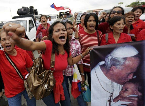 Filipino Catholics stage a demonstration against the passing of a reproductive health law in front of the Senate building in Pasay City.