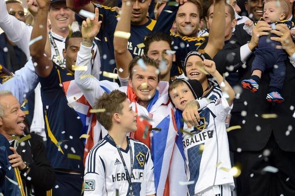 David Beckham celebrates with his sons after the Galaxy defeated the Houston Dynamo, 3-1, to win the 2012 MLS Cup at Home Depot Center.