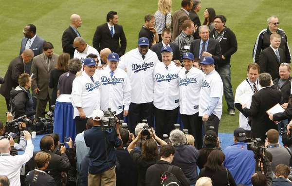 The Dodgers new ownership group addresses the media on May 13 at Dodger Stadium.