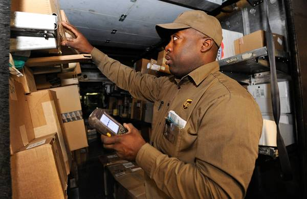 UPS driver Keith Short uses a hand-held computer called a DIAD (Delivery Information Acquisition Device), which gives him information for each package he delivers in Baltimore.