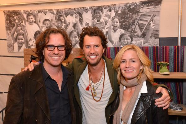 Toms founder Blake Mycoskie, center, with film director Davis Guggenheim and actress Elisabeth Shue at the Toms grand opening on Abbot Kinney Boulevard.
