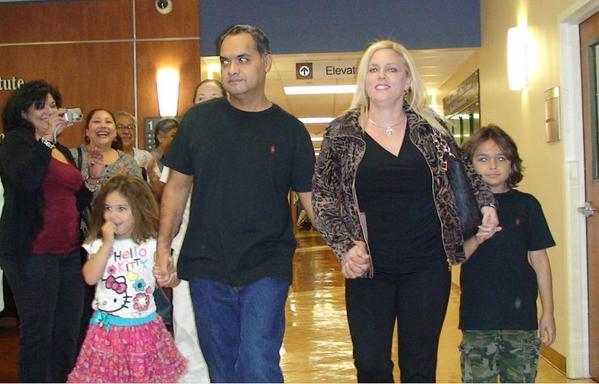 (from left) Daughter Heather, 5, Officer Armando Silva, wife Robin, and son Spencer, 9, leave the hospital together.