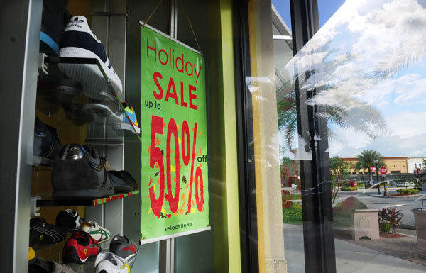 Consumer confidence is at its lowest level in five months amid the holiday shopping season. Above, a sale at a Pembroke Pines, Fla., mall.