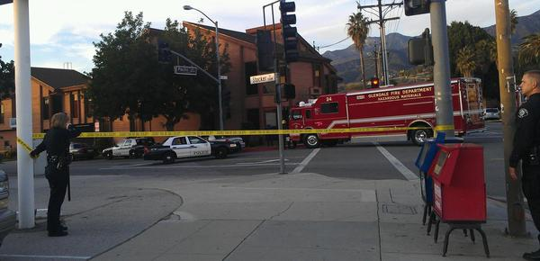 Authorities close off streets near the Temple Sinai of Glendale Friday, Dec. 21, to inspect a suspicious package.