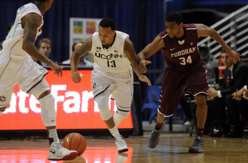 University of Connecticut Huskies guard Shabazz Napier battles Fordham Rams guard Jermaine Myers for a loose ball during the first half Friday at the XL Center.