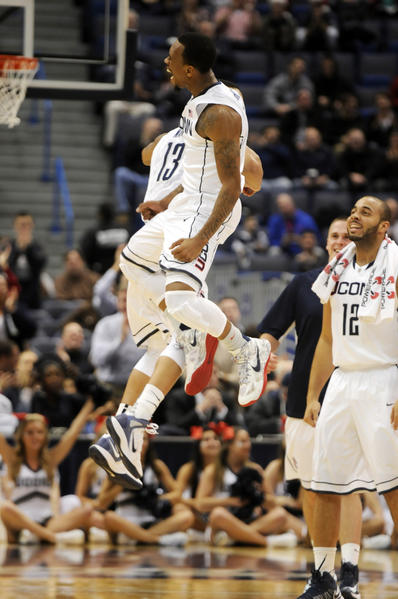 UConn guards Shabazz Napier (13) and guard Ryan Boatright celebrate during a break in the action during the first half.