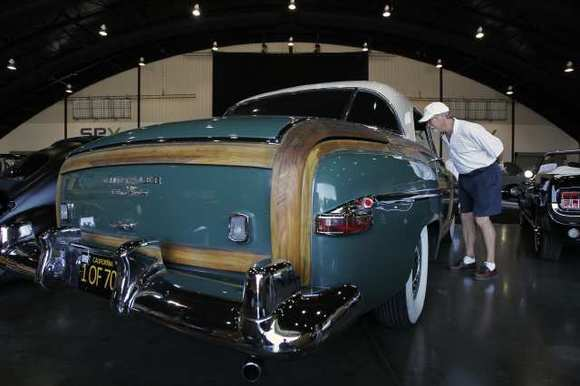 Ron Kramer looks at a 1950 Chrysler Town & Country during the Barrett-Jackson Collector Car Auction at the O.C. Fairgrounds last year.