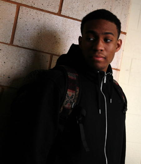 Jabari Parker chats with classmates Friday after school. He didn't play in Simeon's game against Brooks.