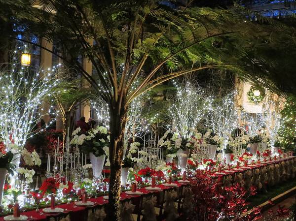 A huge table is set for the festive feast in the Exhibition Hall at Longwood Gardens.