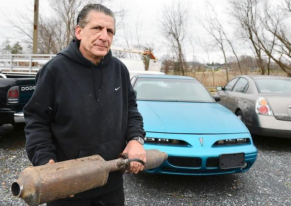 Ron Matyas, owner of Airport Auto Sales on Airport Rd. in Bath stands near the spot he was attacked by two men stealing catalytic converters from numerous cars from his lot, after Matyas approached the men with a handgun.
