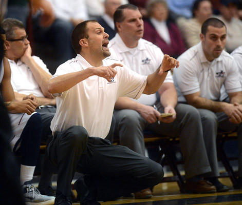 Liberty's Head Coach Chad Landis coaches his team from the sidelines against Freedom High School in the first quarter of their Lehigh Valley Conference boys basketball game Friday night.