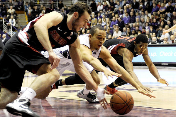 Stanford's Robbie Lemons and Chasson Randle go for a loose ball against Reggie Hearn during the first half.