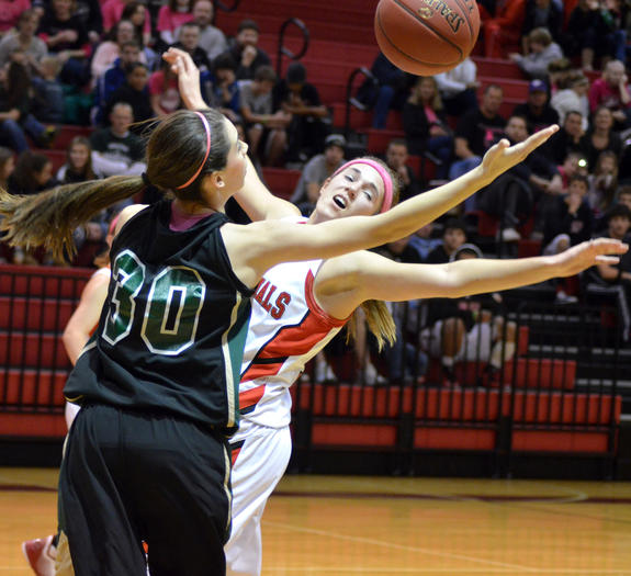 Central Plains freshman Taylor Rolfs (30) and Hoisington junior Jordin Greer battle for a rebound in Friday's game.