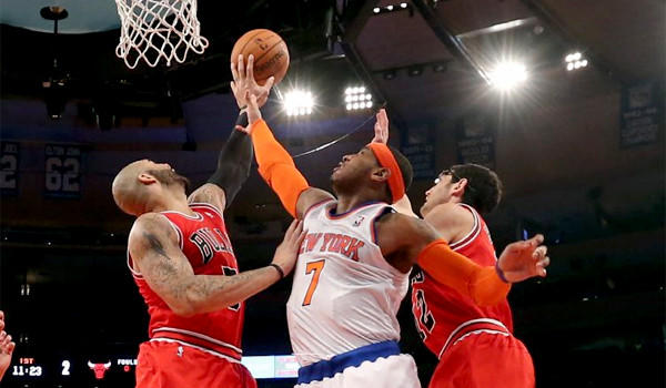 Nicks forward Carmelo Anthony is blocked in the first half of a loss to the Chicago Bulls, 110-106.