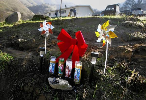 A small roadside memorial pays silent tribute to the four members of a family who were shot to death Dec. 8 and two others who were wounded at the Tule River Indian Reservation.