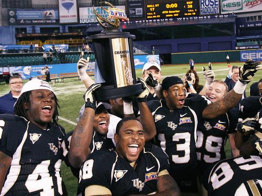 UCF players celebrate after winning the Beef O'Brady's Bowl game of UCF versus Ball S