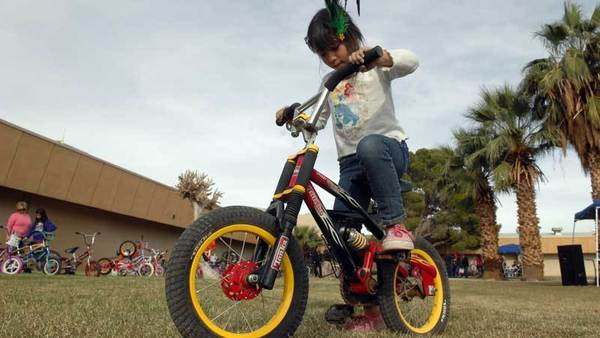 Cloe Mara, 7, tries a bicycle during the Centinela State Prison bike giveaway Friday at the Imperial County Probation Department in El Centro.