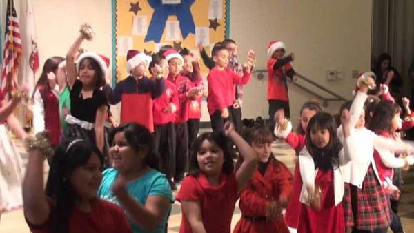 "Dogwood Elementary School students dance while singing ""Rockin' Around the Christmas Tree"" at a Christmas concert held Thursday afternoon."
