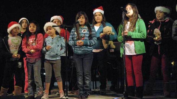 The Blanch Charles Elementary School children's choir sings songs during a candlelight vigil at Crummett Park in Calexico on Friday. The vigil was held in memory of children and educators who died at Sandy Hook Elementary School in Connecticut.