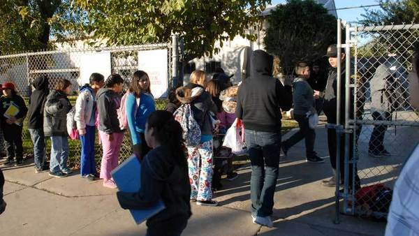 Students line up outside Miguel Hidalgo Elementary School on Friday morning to sign in and leave their backpacks outside of school after rumored threats were made against all Brawley schools.