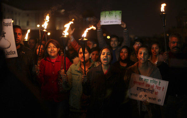 Indian protesters angered by a case of gang rape shout slogans as they march near the president's home in New Delhi.