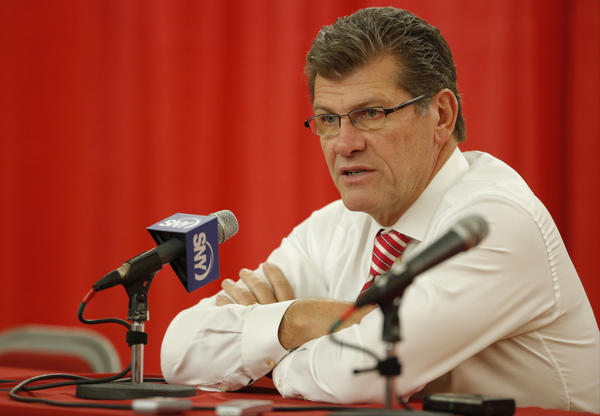 Connecticut Huskies head coach Geno Auriemma talks to reporters after the game against the Hartford Hawks at the Chase Family Arena. UConn defeated Hartford, 102-45.