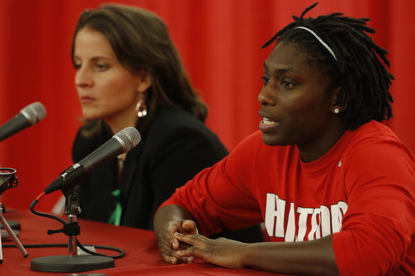 Hartford Hawks guard Daphne Elliott and coach Jennifer Rizzotti talk to reporters after the game with the Connecticut Huskies at the Chase Family Arena. UConn defeated Hartford, 102-45.