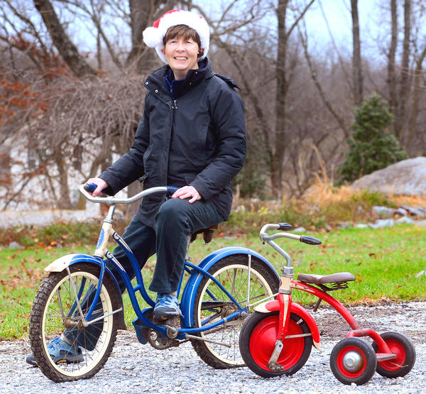 Dr. Mary E. Money of Hagerstown with her favorite childhood toy her blue Schwinn bicycle. At right is a trike that was a hand me down from her older brother.