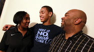 Edward Morrow (center), a 6-foot-4 Simeon sophomore, at home with his 6-1 mother, Nafeesah, and 6-3 father, Edward.