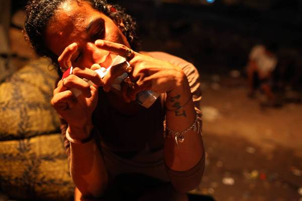 A woman feeds her crack habit in the Mandela slum of Rio de Janeiro. Brazil is dealing with what officials call a crack epidemic.