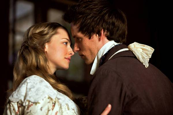 Amanda Seyfried as Cosette and Eddie Redmayne as Marius in 'Les Miserables,' the motion-picture adaptation of the beloved stage musical.