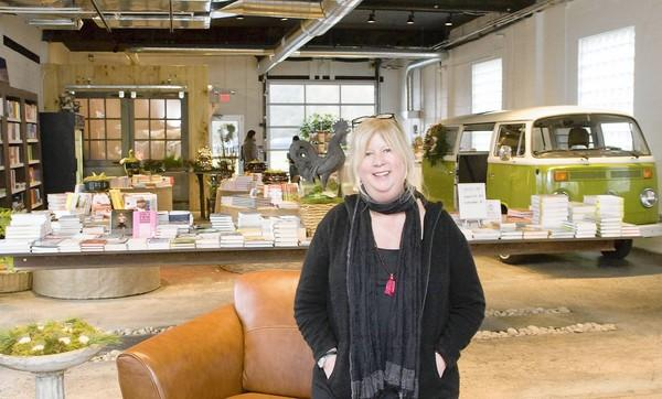 Heidi Rodale, the granddaughter of Rodale founder J.I. Rodale, sits in the lounge area of the Rodale General Store. The store opened Monday at the corner of 10th street and Pennsylvania Ave in Emmaus.