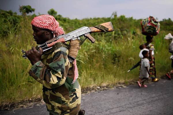 An M23 rebel marches toward the town of Sake, west of Goma, in November.