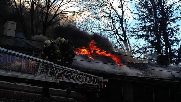 Firefighters battle a fire Saturday afternoon at a two-story house near the intersection of Duke and German streets in Shepherdstown, W.Va.