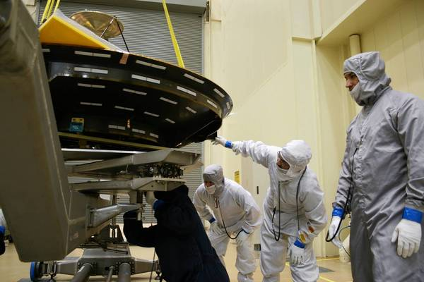 Workers at Lockheed Martin Space Systems south of Denver maneuver an antenna that will be fitted onto the $671-million probe called the Mars Atmosphere and Volatile EvolutioN orbiter, or MAVEN, which needs to be free of earthly contaminants to protect any possible life forms on the Red Planet.