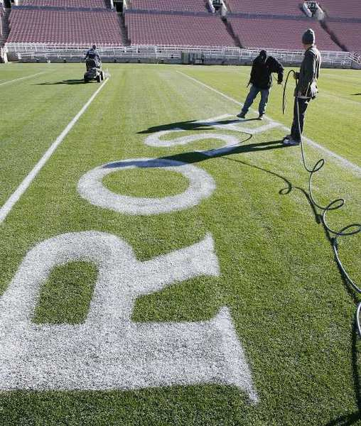 ROSE is painted on the field, part of the artwork at the 50-yard-line, at the Rose Bowl stadium in Pasadena. Everything that goes into preparing for the upcoming Rose Bowl football game takes place on a schedule and behind the scenes.