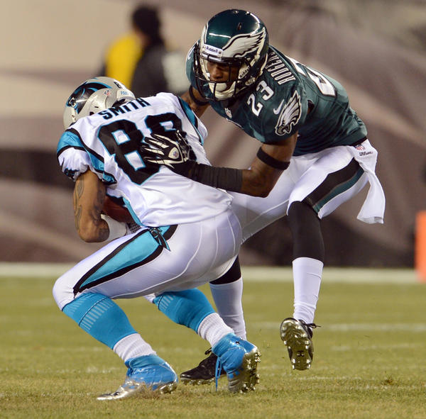 Philadelphia Eagles cornerback Dominique Rodgers-Cromartie (23) tackles Carolina Panthers wide receiver Steve Smith (89) at Lincoln Financial Field in Philadelphia on Monday.