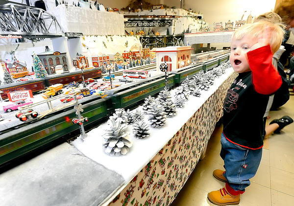 Eaves Black, 2, of Thurmont, Md., waves at a passing train Saturday afternoon during the Trains of Christmas show at the Hagerstown Roundhouse Museum on Burhans Boulevard in Hagerstown.