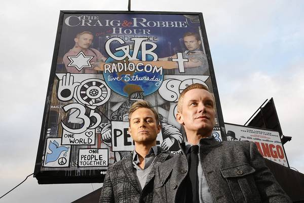 "Craig Olsen, left, and Robbie Laughlin host an online radio show called ""The Craig & Robbie Hour."" The billboard advertising their show was defaced twice."
