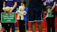 The moment of silence before Saturday's Hartford-UConn women's basketball game was punctuated by the somber ringing of a bell 26 times to commemorate the lives lost at Sandy Hook Elementary School on Dec. 14.