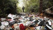 Pot growers' litter piles up in a forest.