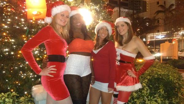 Merrymakers sported Christmas-themed costumes as they walked across Las Olas Boulevard making stops at bars offering drink specials.
