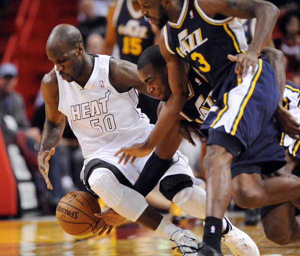 Joel Anthony of the Miami Heat scrambles for a loose ball against the Jazz in the first half.