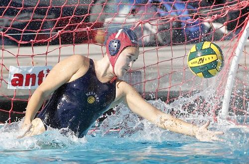 Newport Harbor High junior varsity goalie Carlee Kapana blocks a penalty shot by Costa Mesa during the first half   Saturday.